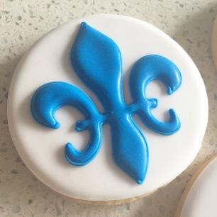 Fleur de lis symbol cookies for Le Jardin Academy's 8th grade graduation.